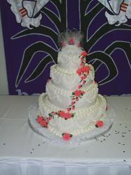 Image of Wedding Cakes with orange flowers with pretty topper