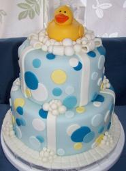 Two tier pokadots cake with rubber ducky topper.JPG