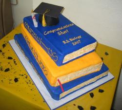 Textbooks graduation cake with graduation cap and diplomma.JPG
