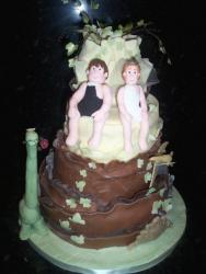 groom and bride in swimming suites wedding cake
