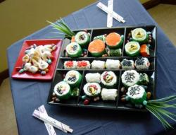 Mini sushi cakes in a box plate.JPG