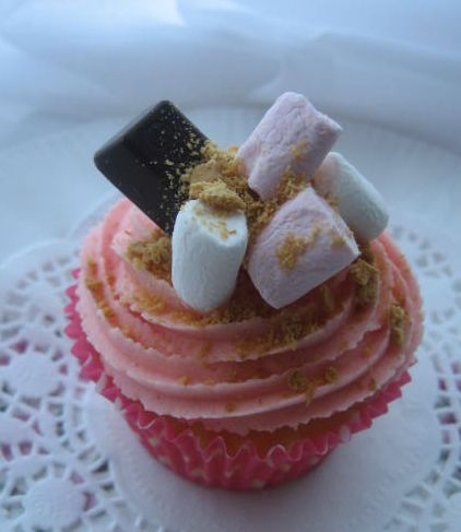 Pink cream cupcake with marshmellows on top.JPG