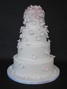 light pink and white wedding cakes picture of wedding cake decor with light pink floral toper 16873