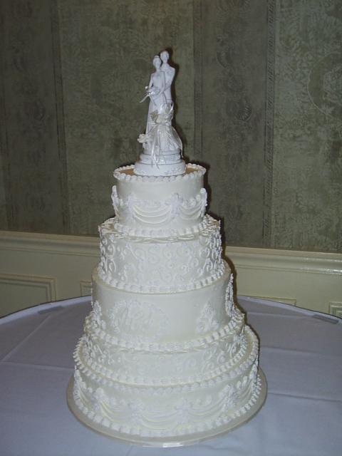 White Wedding Cakes with toper and pretty patterns