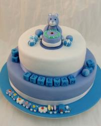 2 tier blue and white Christening cake with teddy bear on top and toy blocks.JPG
