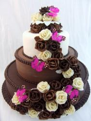 Three tier chocolate round wedding cake with brown and white chocolate flowers and pink butterflies.JPG