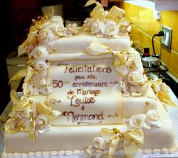 Fiftieth Anniversary white cream Cake in Five Tiers with white roses and yellow ribbons.JPG
