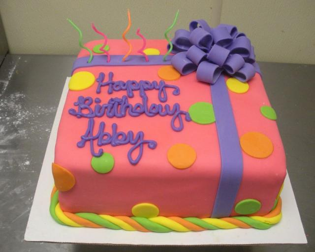 Pink birthday present box cake with purple ribbon.JPG