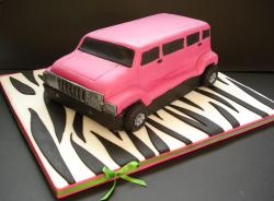Pink Hummer cake on a zebra stripe board.JPG