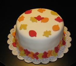 Beautiful Fall cake with colorful leave decor with simple white cake base.JPG