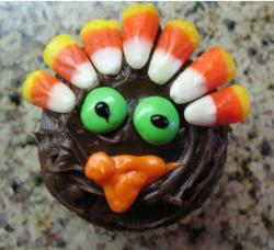 Cute Thanksgiving cake looking at the camare.JPG