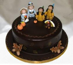 Dark chocolate Thanksgiving cake with figures.JPG