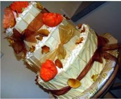 Fancy Thanksgiving Cake in three tiers with bright orange red flowers and brown riboons.JPG