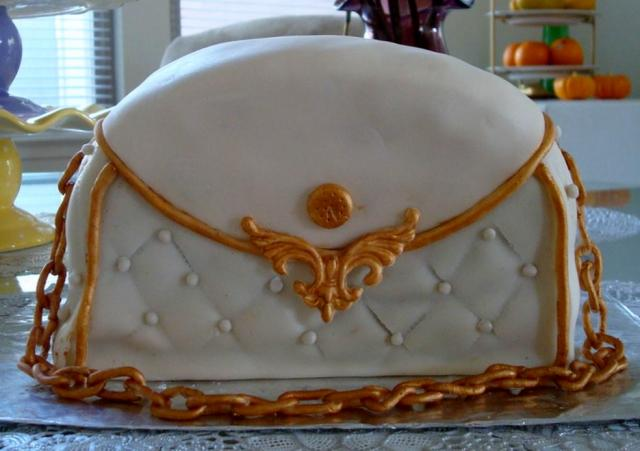 White handbag cake with gold trim and gold chain.JPG
