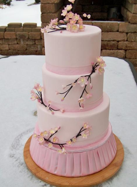 3 level round pink cake with cherry blossoms and branches.JPG