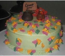 Light green thanksgiving cake with colorful cake decor.JPG