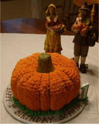Thanksgiving birthday cake with pumpkin shape and figures.JPG
