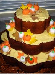 Thanksgiving Cake in three tiers with pumpkin decor.JPG