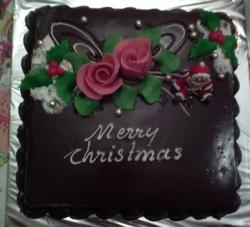 Dark chocolate Christmas cake with pink rose and Santa.JPG
