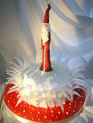 Red and white Christmas cake with Santa topper.jpg