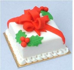 Square English christmas cake with big red bow.JPG