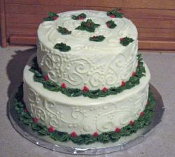 Two tier Christmas cake with red and green decor.JPG