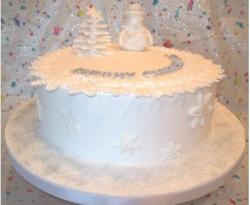 White Christmas cake with snowman figure.JPG