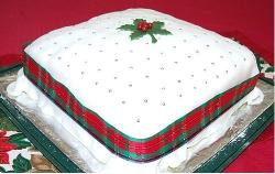 Big square Christmas cake with red and green ribbon.JPG