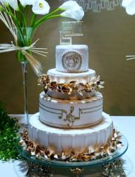 White 4 Tier Wedding Cake with Golden Leaves and Musical Notes.JPG