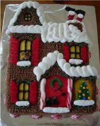 christmas cake decorations of a house with Christmas decor and santa.JPG