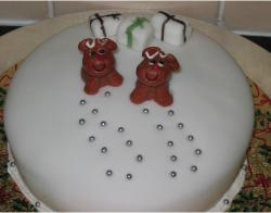 Christmas cake with dog and small gifts toppers.JPG