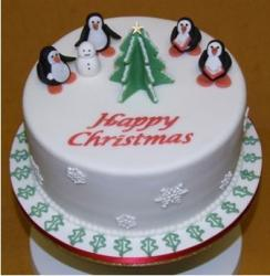 Christmas Cake with penguins with Christmas tree and snowman.JPG