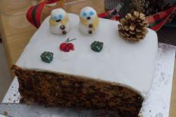 Christmas cake with snowmen and other christmas items.JPG