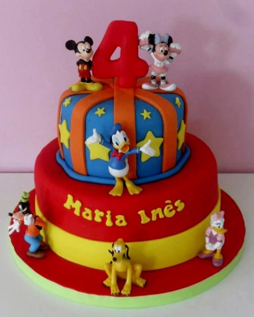 Picture of two tier birthday cake for 4-year-old w/ Disney Characters