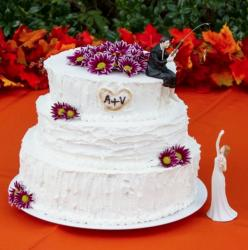 Three Tier Groom Fishing Theme White Wedding Cake with Purple Flowers.JPG