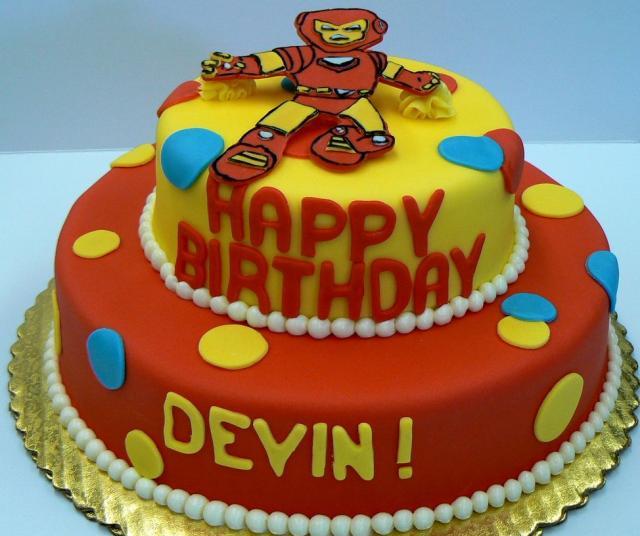 Two Tier Cartoon Robot Theme Birthday Cake In Orange And