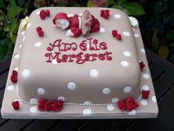 Light brown Christening Cake with red small red flowers.JPG