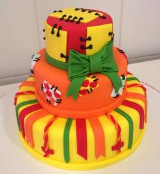 3 tier bright colored cake with stitched fabric green bow.JPG