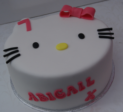 Hello Kitty head shape cake with cat face cake .PNG