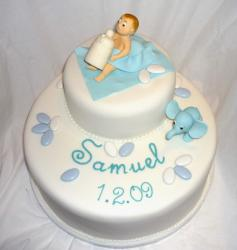 Two tier baby dedication cake with baby and bottle and elephant.JPG