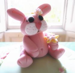 Pink bunny rabbit with yellow flower cake.JPG