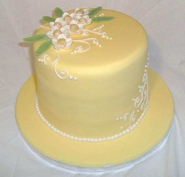 Elegant yellow birthday cake with white pearl beads and flowers.JPG Hi ...