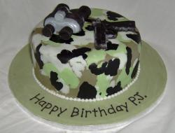 Army theme camo cake with binoculars and pistol.JPG