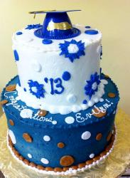 Two Tier Graduation Cake in White and Blue with Cap on top.JPG