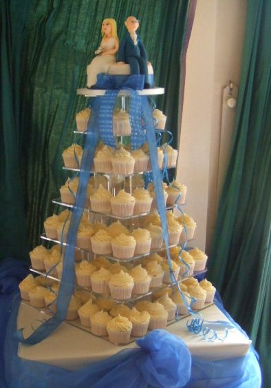Wedding Cupcake tower with bride and groom toppers.JPG