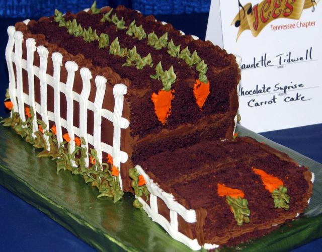 Cool garden theme chocolate carrot cake with white fence.JPG