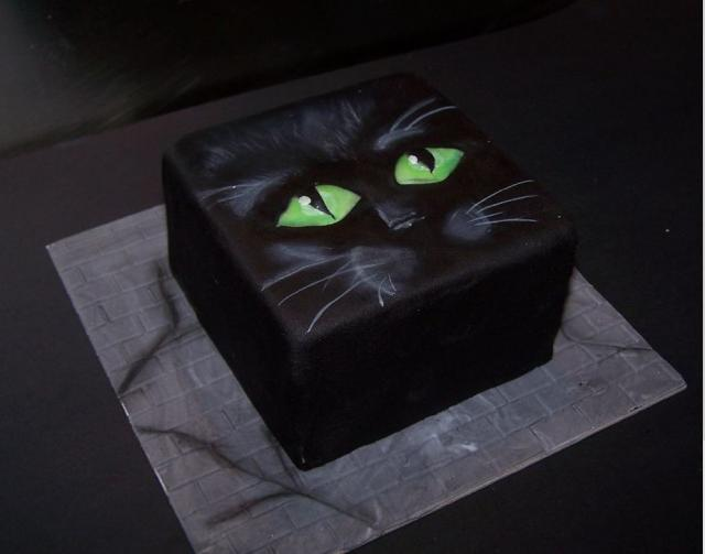 http://www.cakepicturegallery.com/d/15218-2/Square+black+cat+halloween+cake+with+big+green+eyes.JPG