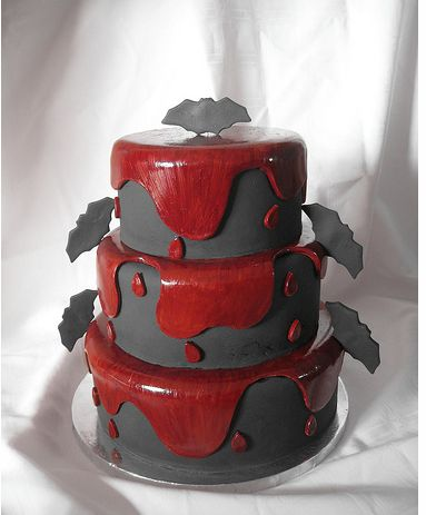 Three tier halloween cake with bats and blood.JPG
