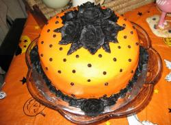 Beautiful orange halloween cake with black roses top.JPG