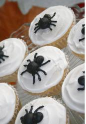 Black spiders on white cupcakes photos.JPG